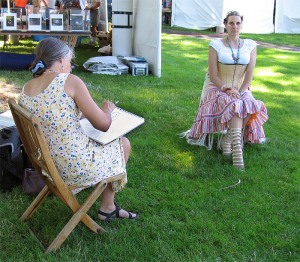 A guest tries her hand at sketching a live model.